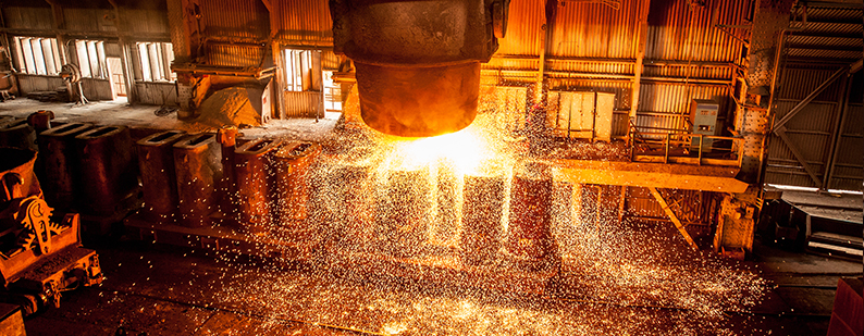 Ladel pour of hot steel in steel mill with sparks